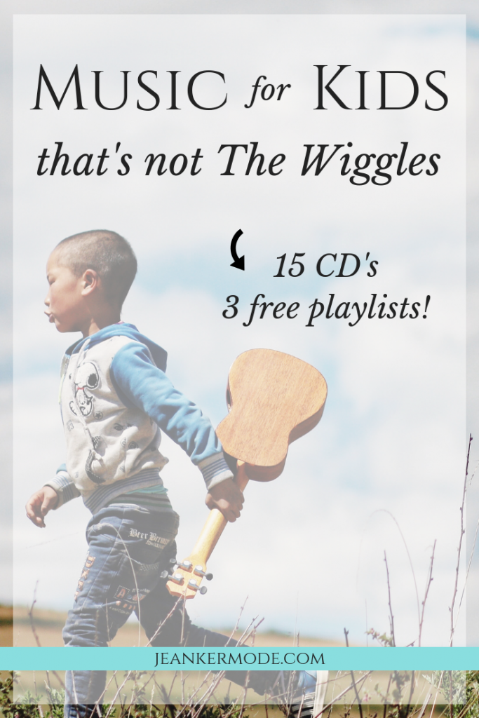 image of a young boy holding a ukulele with text that says: music for kids that's not the wiggles 15 cd's and 3 free playlists jean kermode.com